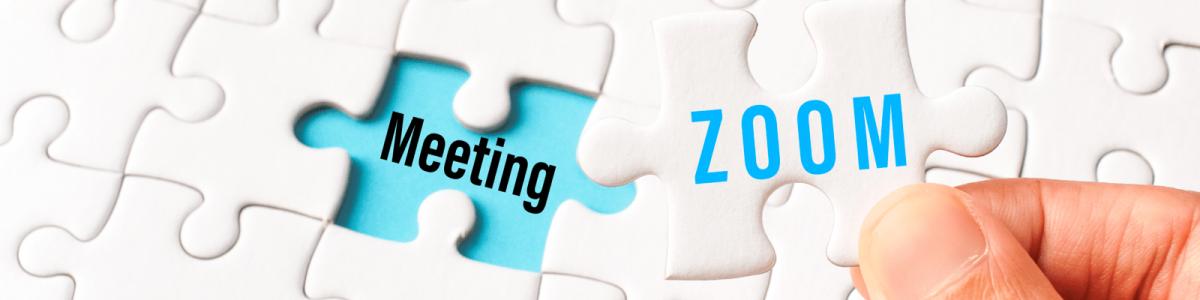 zoomと印字されたジグソーパズルのピースを、meetingと書かれた場所にはめようとする